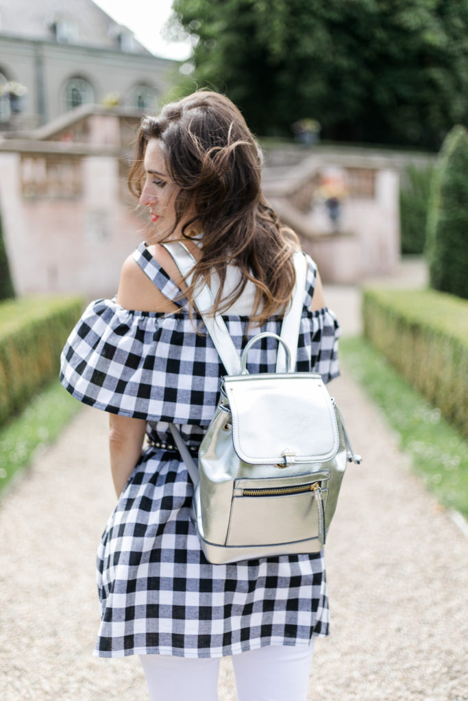 Gingham dress and silver bag